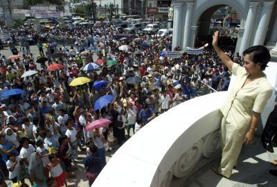 Philippine President Gloria Macapagal Arroyo Waves to